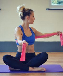 Pilates exercise, spinal rotation with resistance band