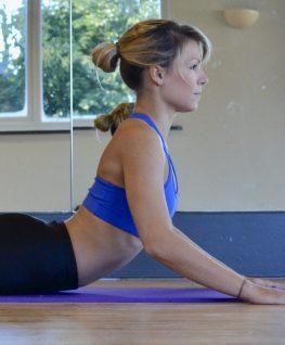 Pilates exercise, swan dive preparation